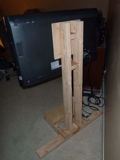 diy tv mount. Attach boards to back of entertainment center? Picture of standback.jpg