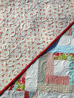 free motion feather swirl quilting.