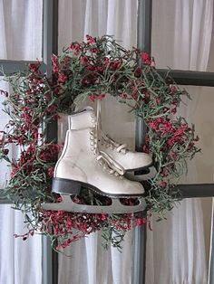 Delicate berry wreath with family ice skates in the center.lovely nostalgic wreath---time to dust off my childhood skates for this special treatment! or use baseball gloves etc. Christmas Door, Primitive Christmas, Country Christmas, All Things Christmas, Winter Christmas, Christmas Holidays, Christmas Wreaths, Christmas Crafts, Christmas Decorations