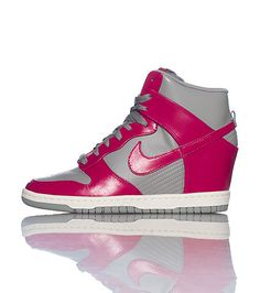 NIKE High top women's sneaker Concealed wedge heel Lace closure Connecting signature swooshes on sides Perforated toe for breathability Grey and pink