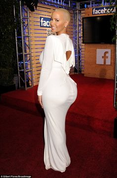 f02caf0ea5 Kanye West s ex Amber Rose shows off a curvy booty in clinging dress