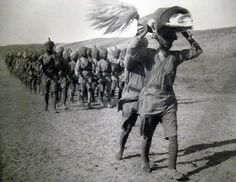 World War I :: Sikh Soldiers of British India Army Marching in Mesopotamia Carrying Guru Granth Sahib
