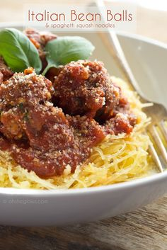 Italian Bean Balls with Spaghetti Squash pasta. A flavourful alternative to traditional meat balls! Vegan + gluten-free + soy-free. Recipe by Oh She Glows.