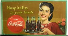 Hospitality in your hands.   Coca Cola Ad.  Woman w tray.