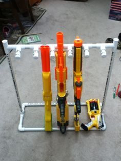 DIY Nerf gun storage rack using PVC pipes. Nerf Gun Storage, Toy Storage, Storage Rack, Storage Ideas, Pistola Nerf, Nerf Party, Pvc Pipe Projects, Toy Rooms, Kids Rooms