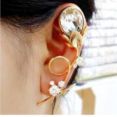 One piece Flower and rhinestone ear cuff A conversation piece! Ear cuffs are super cute and sexy! They draw attention to the face and jawline!!!  Perfect for short cuts and up dos Brand new ! Never worn! 1 piece! Still in plastic! Jewelry Earrings