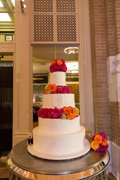 Bridal cake with hot pink and orange floral | Bella Flora | Frosted Art Bakery | Larry Sengbush Photography | Caroline Events http://carolineevents.com