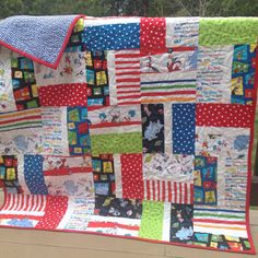 Quilt for baby or child - Dr. Seuss prints on a fun two sided crib or lap quilt. 100% cotton. Warm and soft. Perfect gift for a little boy in your life.