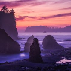 "A view worth waiting for: Deep violets and pinks overtake the sky at Olympic National Park in Washington. Of this moment, photographer Grant Longenbaugh says, ""The sea stacks were beautifully accentuated by the moist air, and while the actual sunset was quick and relatively colorless, about 30 minutes after, the sky lit up."" Soak in the scenery of the park's more than 70 miles of wild coastline by hiking, backpacking, exploring tidepools and more. Photo courtesy of Grant Longenbaugh."