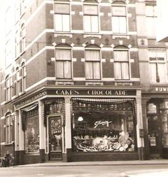 1940's. View of the Jamin store at the Haarlemmerstraat in Amsterdam. Jamin is a retail chain of chocolaterie shops, as well as of the former candy factory established in 1870 by Cornelis Jamin (1850-1907). In the 1950s and 1960s the chain grew to over 600 Jamin shops. The company later got in trouble and went bankrupt in 1985. From 1993 to July 2010 Jamin was owned Ahold NV. In July 2010, Jamin was sold to Hermans Holding in Hoorn. #amsterdam #1940 #Jamin