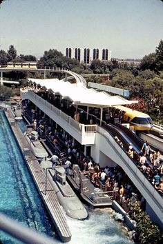 Disneyland guests board the Monorail and Submarine Voyage as the Howard Johnson Hotel & Water Playground looms beyond Tomorrowland, Disneyland Area Hotels, Disneyland Tomorrowland, Disneyland History, Disneyland California, Disneyland Park, Walt Disney Land, Walt Disney Imagineering, Disney Rides, Disney Parks