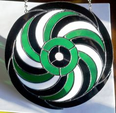A spiral crop circle formation turned stained glass... It took me a while to figure out a color arrangement and I liked this one very much and it came out beautifully!
