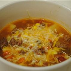 Texas Cowboy Stew Recipe----Hearty, filling and man-pleasing describes this stew. Link sausage, ground beef, cumin, chilies, and chili powder is what gives this soup its Southwest flavor. This dish is quick, easy, and tastes best when it simmers in a slow cooker or even on the stove all day.