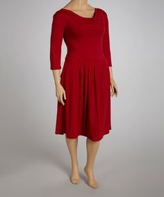 A girl can't go wrong with a classic like this. With figure-pleasing drape and playful front pockets, this three-quarter sleeve dress masters casual chic.Measurements (size 1X): 44'' long from high point of shoulderMannequin measurements: 5'5'' tall; 41.25'' chest; 32'' waist; 41.5'' hips95% polyester / 5% spandex...
