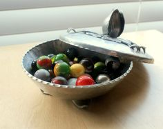 A vintage Rodney Kent tulip patterned aluminum covered dish. Love the marbles, too!