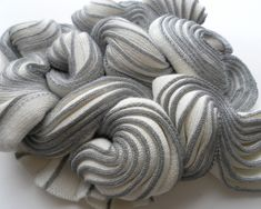 This project was about exploring three-dimensional shapes in textile form. The knitted fabrics have been worked into to create soft structures.