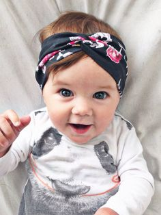 She is such a cutie!! Black floral turban by turbansfortots on Etsy