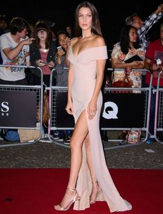 """Bella Hadid accepts GQ's """"Model of the Year"""" Award in metallic, gold sandals on September 6, 2016 at Tate Modern in London."""