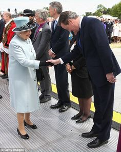 The Queen greeting the Prime Minister David Cameron at Runnymede this morning. The Queen is the patron of the Magna Carta Trust. She and other members of the Royal Family including The Duke of Edinburgh and Prince William were there celebrating the 800th anniversary of the sealing of the document.