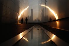 Stunning effect. A man walks through the 9/11 Empty Sky memorial at sunrise across from New York's Lower Manhattan and One World Trade Center in Liberty Station. (Financial Times)