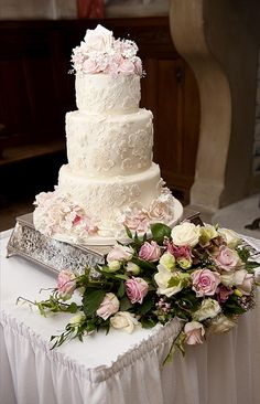 Three tier ivory and pink lace cake