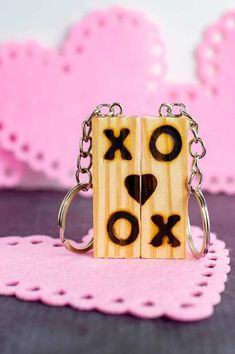 This is such a fun Valentines Day DIY for teens and adults. I love how you can repurpose a dollar store Tumbling Tower block game into fun matching keychains with a wood burning tool. Surprisingly, the wood comes from The Dollar Tree version of a Jenga game. It's called Tumbling Tower Game in the dollar store.Don't be worried about using a wood burning tool. Once you realize that it's easy, you will want to be customizing more items with it! Tips for Using a Wood Burning Tool Use… Valentine Special, Valentines For Kids, Valentine Day Crafts, Valentine Heart, Dollar Store Crafts, Dollar Stores, Game Pieces, Puzzle Pieces, Valentine's Day Diy
