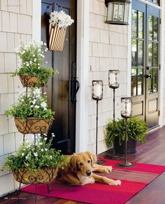 Just love the over sized rug at the front door! Brings a big splash of spring color!!  (Botanica Tiered Planter, Star Spangled Door Bucket, Entertaining Bucket)