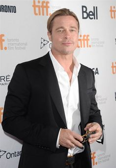 """Actor Brad Pitt arrives at the """"12 Years a Slave"""" premiere during the 2013 Toronto International Film Festival on Sept. 6."""