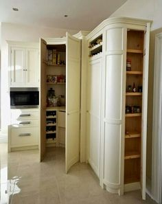 Love this. Very much what I'm after in my kitchen. Tall units housing fudge freezer ovens and food storage cupboards.