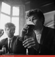 Teddy boys having a pint in the Prospect of Whitby by Hanry Grant, 1965.