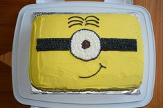 Minion Cake.  I saw a lot of fantastic minion cakes that I knew I could never re-create.  So I came up with this idea.  It was super easy and required very little skill!  You can change the hair, mouth, eye # to make your child's favorite minion face.  I wrote happy birthday on the front side.