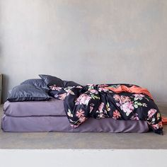 Elegant Floral Duvet Covers & Bedding - Schlossberg Sophia Noir.  Schlossberg's Sophia Noir duvet covers and bedding features a pattern of wild roses and Michaelmas daises on a deep midnight blue background.   http://www.jbrulee.com/cat-schlossberg-bonjour-of-switzerland-bedding.cfm