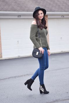 Olive Off-the-Shoulder Sweater, Skinny Jeans, Black Fedora, Crossbody Bag, and Embroidered Booties Spring Outfit