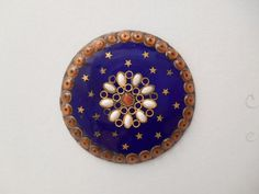 18th century colbalt blue enamel button with stars and a border of radiating foil pierreries.  Page button auctions. counter enameled, lg