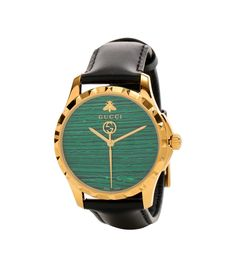 Gucci - Le Marché des Merveilles 38mm leather watch - Gucci's G-Timeless watch will make a subtle statement and effortlessly elevate everything else you have on. The black calfskin strap makes an understated backdrop to the gold-tone design and vibrant green stone-effect dial. The label's iconic GG motif adorns the second hand, while bee and logo detailing at 12 o'clock locks in the luxe status to ensure you'll be on time and looking chic. seen @ www.mytheresa.com