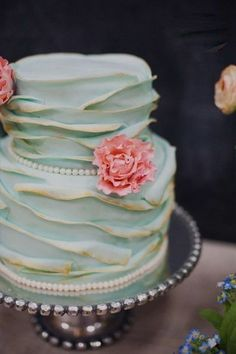 Lovely ruffled wedding cake- I'd like one white with Gold trimming and pink flowers :D