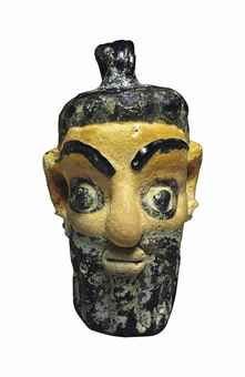 A CARTHAGINIAN GLASS HEAD PENDANT CIRCA 5TH-4TH CENTURY B.C.
