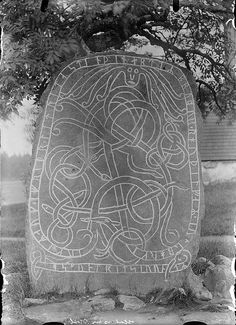 "Rune stone, Holm, Uppland, Sweden The rune stone has been used as a stair stone in the cemetary gate. The inscription says: ""Joger and Åfrid had this stone raised in memory of the brother of Rodälv in Örberg (?). Åsmund carved the runes"". Parish (socken): Holm Province (landskap): Uppland Municipality (kommun): Enköping County (län): Uppsala"