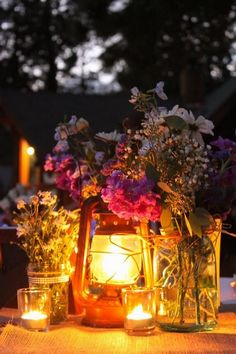 Kerosene lantern wedding centerpiece / http://www.deerpearlflowers.com/camp-wedding-ideas/