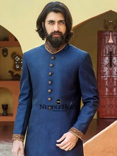 Blue sherwani suit design for handsome groom in Bolingbrook Illinois. Explore one stop shopping destination for rich and traditional sherwanis at Needlehole Blue Sherwani, Sherwani Groom, Mens Sherwani, Wedding Sherwani, Pakistani Wedding Dresses, Groom Outfit, Groom Dress, Men Dress, Wedding Men