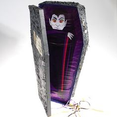 Vampire Coffin Pop Out Pinata by Century Novelty. $15.95. Haunted Halloween Games. Your guests will love this classic pinata game at your upcoming Halloween party! The Vampire Coffin Pop Out Pinata is a great way to turn up the fun factor at your Halloween celebration! Children of all ages will enjoy the treats inside of this spooky Halloween pinata! Coffin pinata is approximately 13 x 24 1/2. Pinata buster not needed, pull strings from the bottom to release. Simply pul...