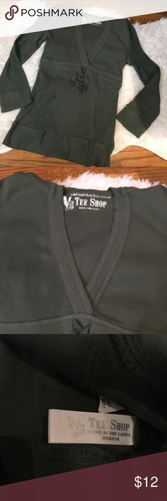 Green V neck hoodie/top Green top with hoodie. Super cute. Size says medium but fits more like a small. EUC Tops Sweatshirts & Hoodies
