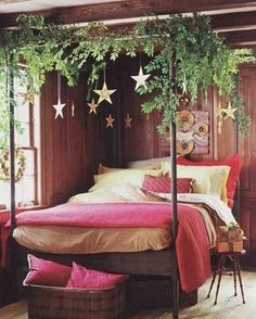 Decorating the bedroom. Red bedding, garland, and stars or snowflakes hanging from the ceiling.