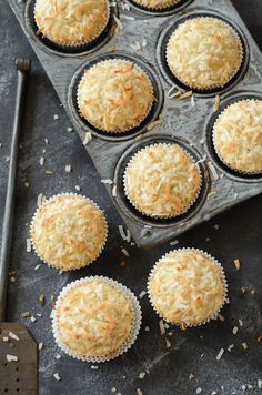*sub flax egg for egg in recipe* Coconut Banana Crunch Muffins -- a glorious crunchy sweetened toasted coconut top on top of a moist banana and coconut flavored muffin!