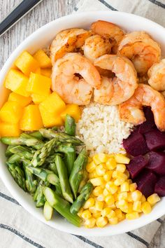 Healthy veggie-packed recipe! This Shrimp 'n Veggie Power Bowl is as delicious as it is beauteous... Just 254 calories & 2.5g fat! Get the recipe from Hungry Girl!