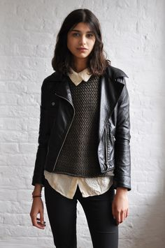 mica arganaraz. leather jacket. white button-down. sweater. menswear-inspired.