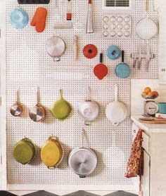 Pegboard pot rack. LOVE this and totally going to do this, seeing as it would solve our kitchen storage problem, since I've got maybe just a bit too much kitchen stuff...