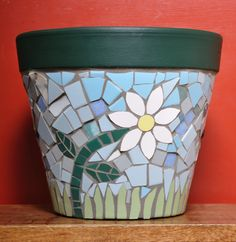 Here is my step-by-step guide to show you how I created this cheerful, summery mosaic flower pot for the garden. You can also buy a kit to help you to make your own!! You will need:  MATERIALS Plai…