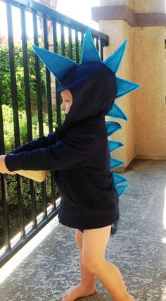 Easy DIY Halloween Costume Dinosaur - That's SO FUNNY!!  This is how I made my son's dragon costume 10 years ago.  But I used sheets of foam and sewed it on with fishing line.  I did it all by hand and sewed a big tail to the bottom of the sweatshirt.  It was fun!