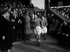 Liverpool captain Bob Paisley leading the team on to the pitch.